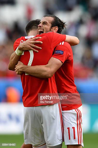 Gareth Bale of Wales celebrates his team's win with his team mate Chris Gunter after the UEFA EURO 2016 Group B match between Wales and Slovakia at...