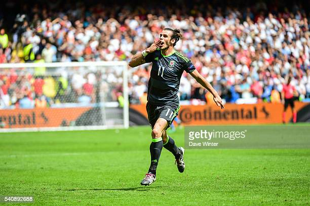 Gareth Bale of Wales celebrates opening the scoring during the UEFA EURO 2016 Group B match between England and Wales on June 16 2016 in Lens France