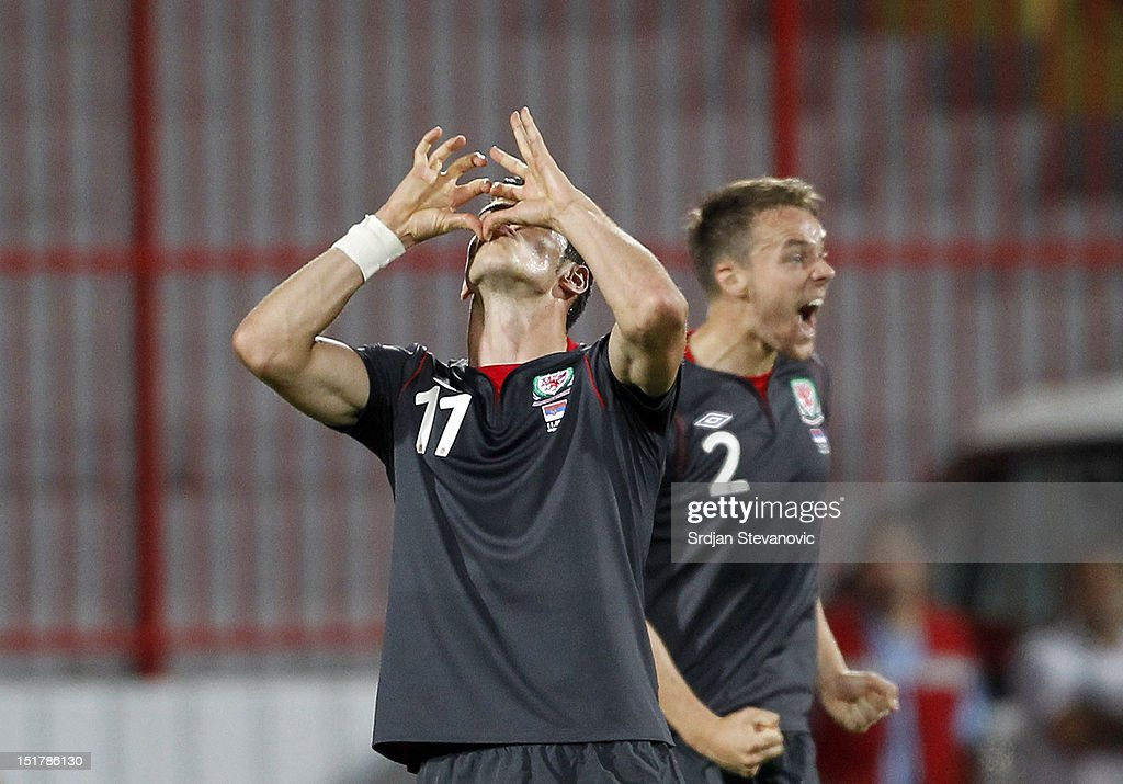 Gareth Bale (L) of Wales celebrates scoring a goal during the FIFA 2014 World Cup Qualifier at stadium Karadjordje Park between Serbia and Wales on September 11, 2012 in Novi Sad, Serbia