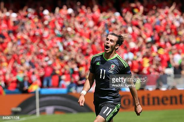 Gareth Bale of Wales celebrates scoring a goal during the UEFA Euro 2016 Group B match between England and Wales at Stade BollaertDelelis in Lens...