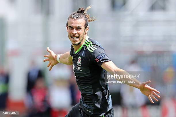 Gareth Bale of Wales celebrates scoring a goal to make the score 01 during the UEFA EURO 2016 Group B match between England v Wales at Stade...