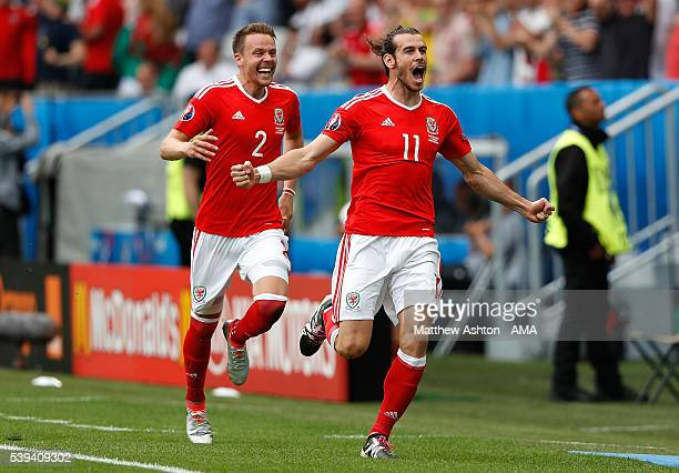Gareth Bale of Wales celebrates scoring a goal to make the score 10 during the UEFA EURO 2016 Group B match between Wales and Slovakia at Stade...