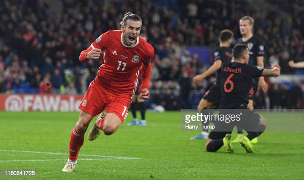 Gareth Bale of Wales celebrates scoring his team's first goal during the UEFA Euro 2020 qualifier between Wales and Croatia at Cardiff City Stadium...