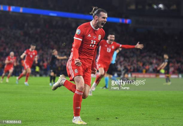 Gareth Bale of Wales celebrates scoring his team's first goal during the UEFA Euro 2020 Qualifier between Wales and Croatia at the Cardiff City...