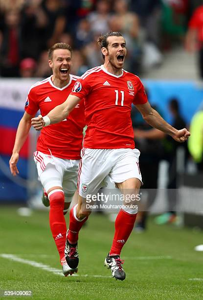 Gareth Bale of Wales celebrates scoring his team's first goal during the UEFA EURO 2016 Group B match between Wales and Slovakia at Stade Matmut...