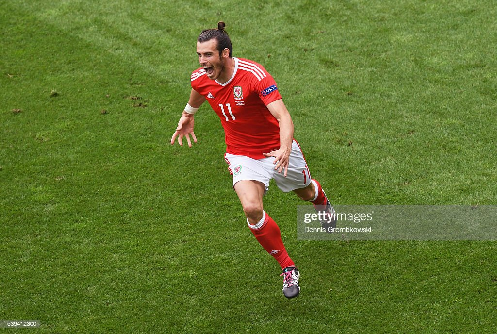 Gareth Bale of Wales celebrates scoring his team's first goal during the UEFA EURO 2016 Group B match between Wales and Slovakia at Stade Matmut Atlantique on June 11, 2016 in Bordeaux, France.