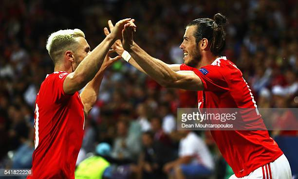 Gareth Bale of Wales celebrates scoring his team's third goal with his team mate Aaron Ramsey during the UEFA EURO 2016 Group B match between Russia...
