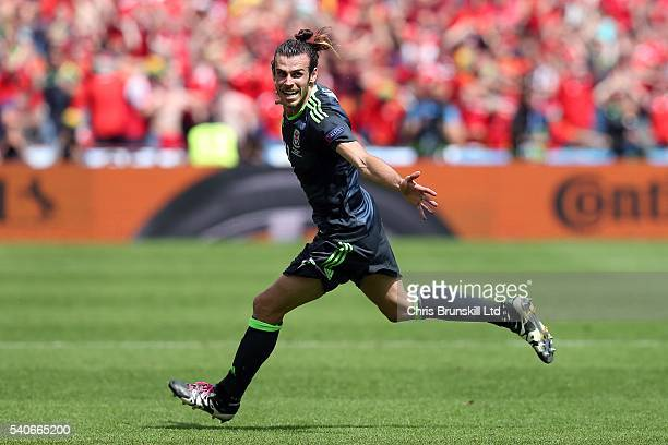 Gareth Bale of Wales celebrates scoring the opening goal during the UEFA Euro 2016 Group B match between England and Wales at Stade BollaertDelelis...