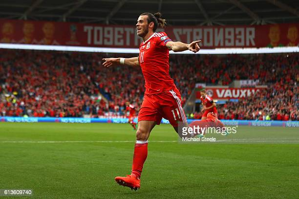Gareth Bale of Wales celebrates scoring the opening goal during the FIFA 2018 World Cup Qualifier Group D match between Wales and Georgia at Cardiff...
