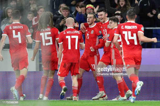 Gareth Bale of Wales celebrates scoring their 1st goal during the UEFA Euro 2020 qualifier between Wales and Croatia at Cardiff City Stadium on...