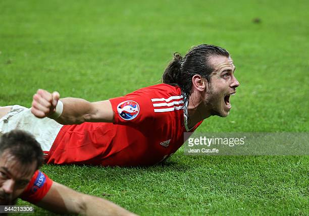 Gareth Bale of Wales celebrates the victory following the UEFA Euro 2016 quarter final match between Wales and Belgium at Stade PierreMauroy on July...