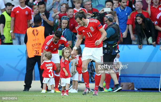 Gareth Bale of Wales celebrates the victory with his daughter Alba Bale following the UEFA EURO 2016 round of 16 match between Wales and Northern...