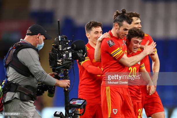 Gareth Bale of Wales celebrates victory with team mates Harry Wilson, Daniel James and James Lawrence following the FIFA World Cup 2022 Qatar...