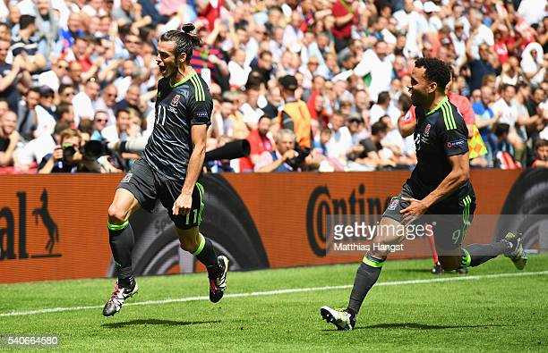 Gareth Bale of Wales celebrates with his teammates after scoring the first goal during the UEFA EURO 2016 Group B match between England and Wales at...