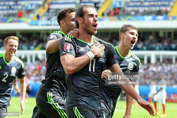 Gareth Bale of Wales celebrates with his teammates afterscoring a goal to make the score 01 during the UEFA EURO 2016 Group B match between England v...
