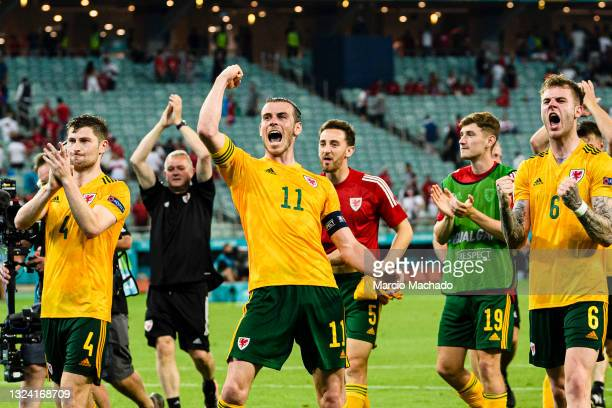 Gareth Bale of Wales celebrates with his teammates and supporters after winning Turkey during the UEFA Euro 2020 Championship Group A match between...