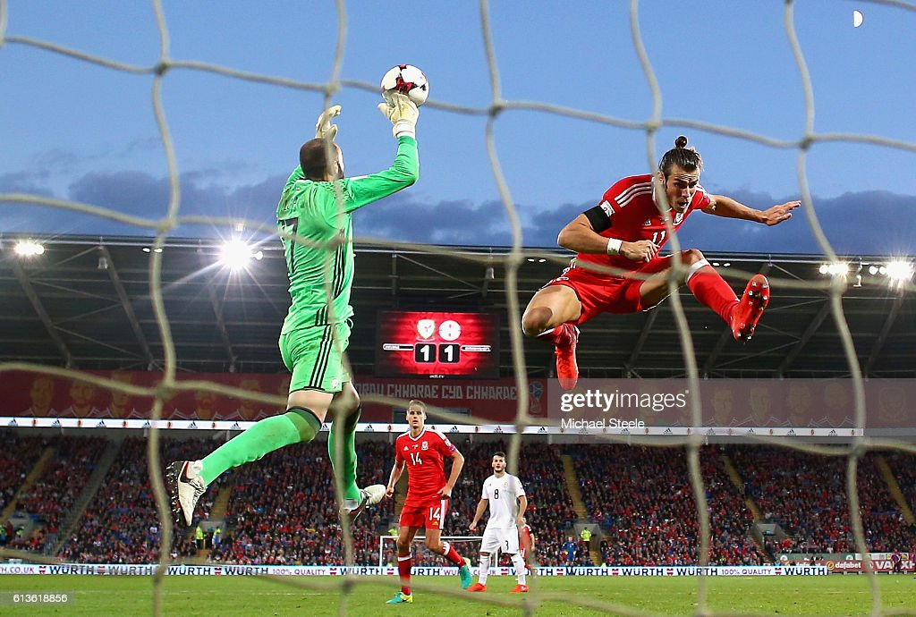 Gareth Bale of Wales challenges goalkeeper Giorgi Loria of Georgia during the FIFA 2018 World Cup Qualifier Group D match between Wales and Georgia at Cardiff City Stadium on October 9, 2016 in Cardiff, Wales.
