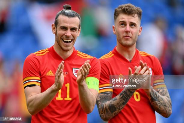 Gareth Bale of Wales claps the fans after the international friendly match between Wales and Albania at Cardiff City Stadium on June 05, 2021 in...