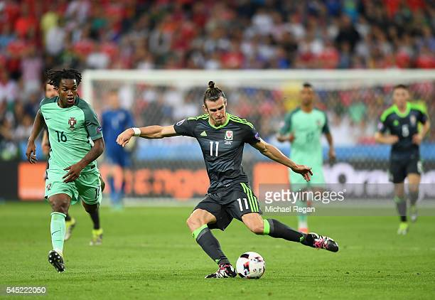 Gareth Bale of Wales crosses the ball under pressure from Renato Sanches of Portugal during the UEFA EURO 2016 semi final match between Portugal and...