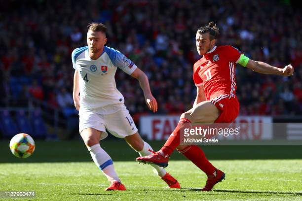 Gareth Bale of Wales has a shot past Lukas Stetina of Slovakia during the 2020 UEFA European Championships group E qualifying match between Wales and...