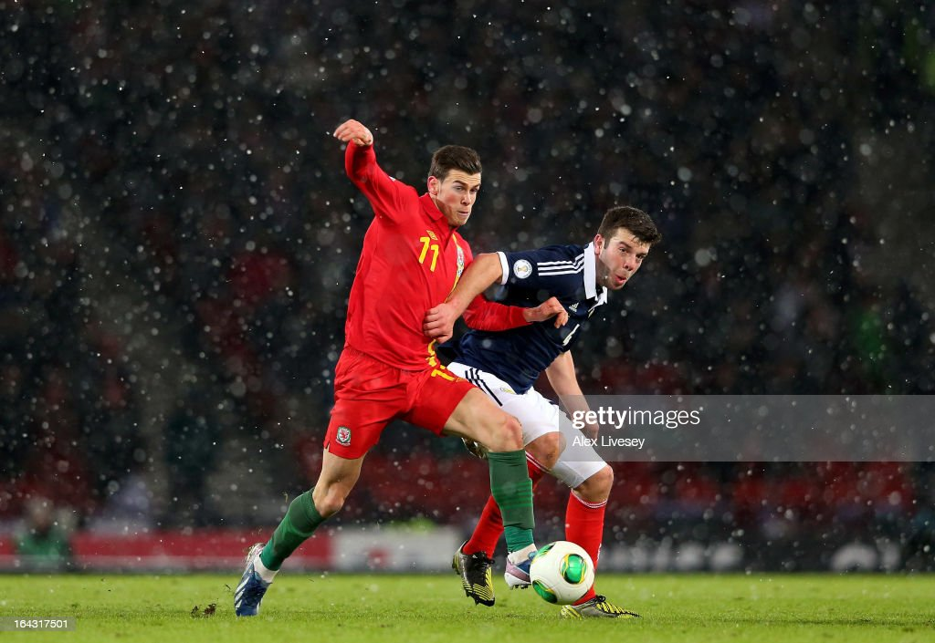 Gareth Bale of Wales holds off a challenge from Grant Hanley of Scotland during the FIFA 2014 World Cup Group A qualifying match between Scotland and Wales at Hampden Park on March 22, 2013 in Glasgow, Scotland.