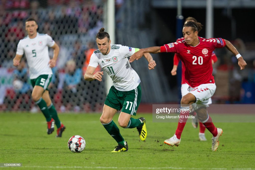 Gareth Bale of Wales holds off the challenge from Yussuf Poulsen of Denmark during the UEFA Nat Ceres Parkions League B group four mat Ceres Parkch between Denmark and Wales at Ceres Park on September 9, 2018 in Aarhus, Denmark.
