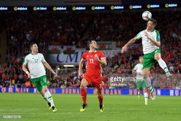 Gareth Bale of Wales in action with Ciaran Clark and Stephen Ward of Republic of Ireland during the UEFA Nations League B group four match between...