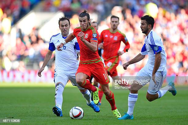 Gareth Bale of Wales is closed down by Bibras Natkho of Israel and Orel Ogani of Israel during the UEFA EURO 2016 group B qualifying match between...