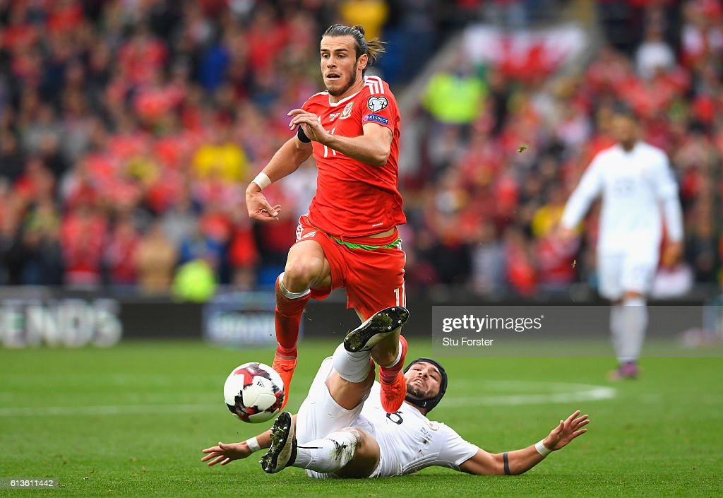 Gareth Bale of Wales is fouled by Murtaz Daushvili of Georgia during the FIFA 2018 World Cup Qualifier Group D match between Wales and Georgia at Cardiff City Stadium on October 9, 2016 in Cardiff, Wales.