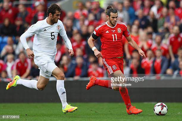 Gareth Bale of Wales is tracked by Solomon Kverkvelia of Georgia during the FIFA 2018 World Cup Qualifier between Wales and Georgia at Cardiff City...