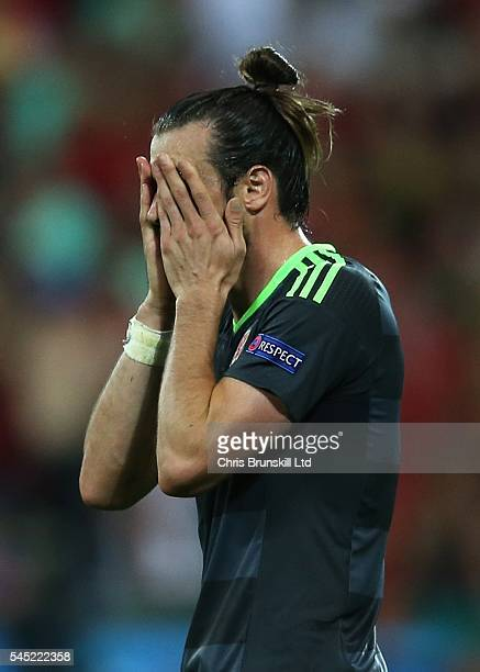 Gareth Bale of Wales looks dejected during the UEFA Euro 2016 Semi Final match between Portugal and Wales at Stade de Lyon on July 06 2016 in Lyon...