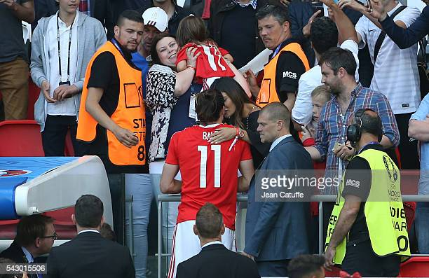 Gareth Bale of Wales meets his wife Emma RhysJones and their daughter Alba Bale following the UEFA EURO 2016 round of 16 match between Wales and...