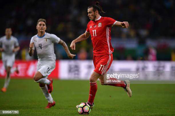 Gareth Bale of Wales national football team dribbles against Uruguay national football team in their final match during the 2018 Gree China Cup...