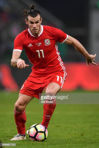 Gareth Bale of Wales national football team kicks the ball to make a pass against Uruguay national football team in their final match during the 2018...
