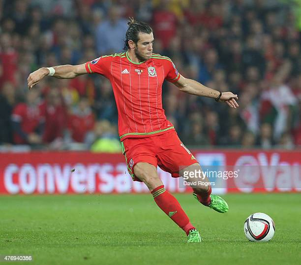Gareth Bale of Wales passes the ball during the UEFA EURO 2016 qualifying match between Wales and Belgium at the Cardiff City Stadium on June 12 2015...