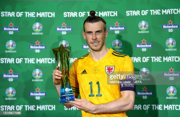 """Gareth Bale of Wales poses for a photograph with the Heineken """"Star of the Match"""" award after the UEFA Euro 2020 Championship Group A match between..."""