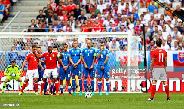 Gareth Bale of Wales prepares for the free kick to score his team's first goal during the UEFA EURO 2016 Group B match between Wales and Slovakia at...