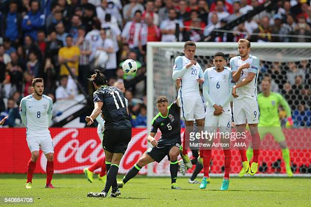 Gareth Bale of Wales scores a goal to make the score 01 during the UEFA EURO 2016 Group B match between England v Wales at Stade BollaertDelelis on...