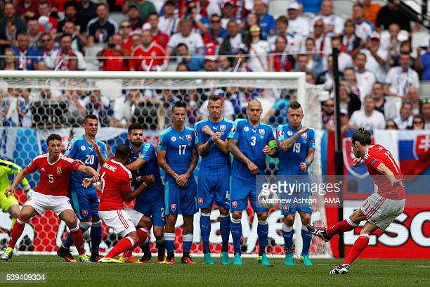 Gareth Bale of Wales scores a goal to make the score 10 during the UEFA EURO 2016 Group B match between Wales and Slovakia at Stade Matmut Atlantique...
