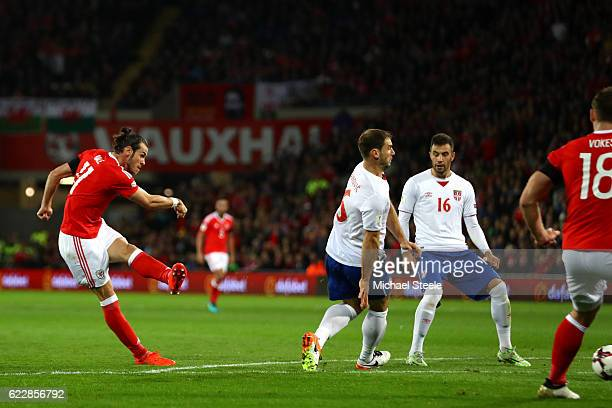 Gareth Bale of Wales scores the first goal during the FIFA 2018 World Cup Qualifier between Wales and Serbia at Cardiff City Stadium on November 12...