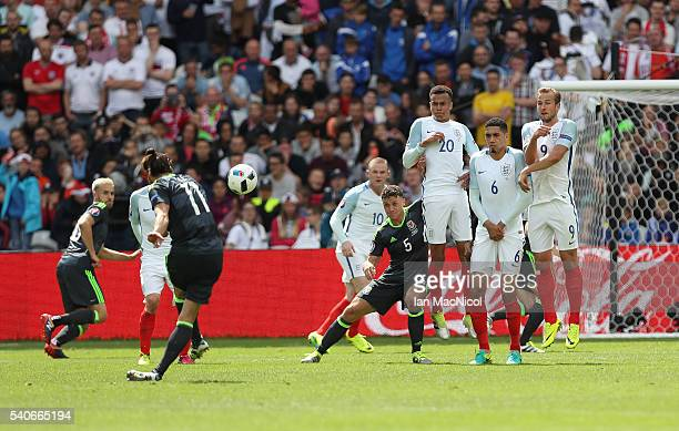 Gareth Bale of Wales scores the opening goal during the UEFA EURO 2016 Group B match between England v Wales at Stade BollaertDelelis on June 16 2016...