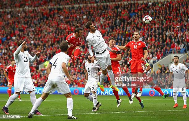 Gareth Bale of Wales scores the opening goal with a header during the FIFA 2018 World Cup Qualifier Group D match between Wales and Georgia at...