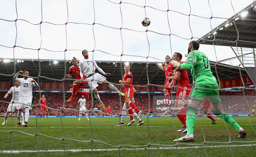 Gareth Bale of Wales scores the opening goal with a header past Giorgi Loria of Georgia during the FIFA 2018 World Cup Qualifier Group D match between Wales and Georgia at Cardiff City Stadium on October 9, 2016 in Cardiff, Wales.