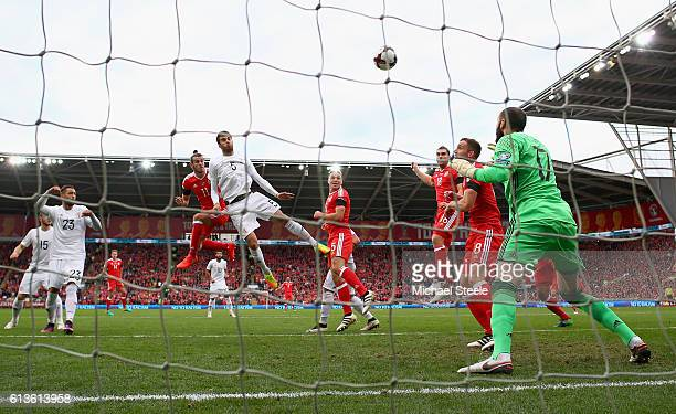 Gareth Bale of Wales scores the opening goal with a header past Giorgi Loria of Georgia during the FIFA 2018 World Cup Qualifier Group D match...