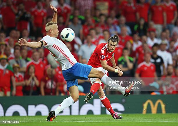 Gareth Bale of Wales shoots at goal while Vasili Berezutski of Russia tries to block during the UEFA EURO 2016 Group B match between Russia and Wales...