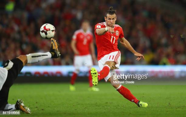 Gareth Bale of Wales shoots during the FIFA 2018 World Cup Qualifier between Wales and Austria at Cardiff City Stadium on September 2 2017 in Cardiff...