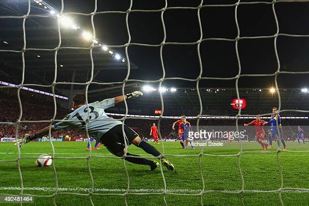 Gareth Bale of Wales shoots past goalkeeper Ferran Pol of Andorra to score their second goal during the UEFA EURO 2016 qualifying Group B match...