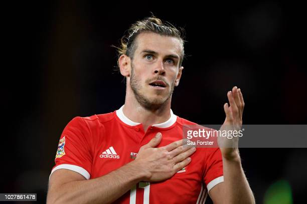 Gareth Bale of Wales shows appreciation to the fans as he is substituted off during the UEFA Nations League B group four match between Wales and...