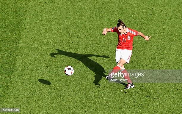 Gareth Bale of Wales takes a free kick during the UEFA EURO 2016 round of 16 match between Wales and Northern Ireland at Parc des Princes on June 25...
