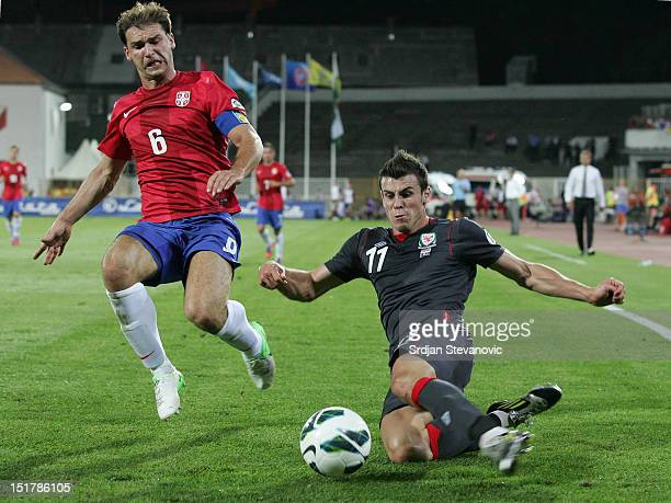 Gareth Bale of Wales try to shoot the ball near Branislav Ivanovic of Serbia during the FIFA 2014 World Cup Qualifier at stadium Karadjordje Park...
